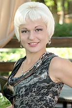 Russian girl Galina,31 years old with hazel eyes and blonde hair.