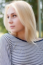 Ukrainian girl Lada,24 years old with grey eyes and blonde hair.
