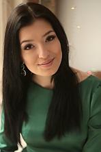Ukrainian girl Viktoria,22 years old with brown eyes and dark brown hair.