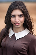 Ukrainian girl Mary,30 years old with grey eyes and light brown hair.