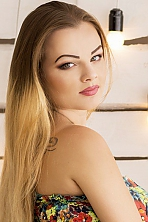 Ukrainian girl Yana,22 years old with green eyes and blonde hair.