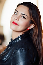 Ukrainian girl Tatiana,29 years old with green eyes and dark brown hair.
