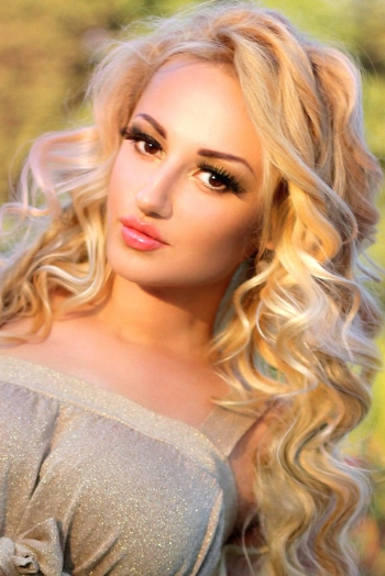Ukrainian girl Aleksandra,27 years old with brown eyes and blonde hair.