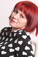 Ukrainian girl Margarita,21 years old with green eyes and red hair.