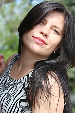 Ukrainian girl Tatyana,34 years old with green eyes and dark brown hair.
