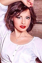 Ukrainian girl Nataly,30 years old with green eyes and dark brown hair.