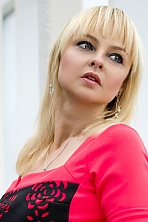 Ukrainian girl Yelena,39 years old with grey eyes and blonde hair.