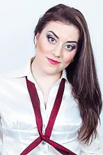 Ukrainian girl Valeria,24 years old with green eyes and dark brown hair.