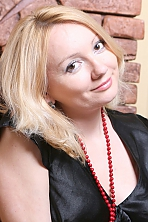 Ukrainian girl Elena,34 years old with brown eyes and blonde hair.