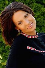 Ukrainian girl Oksana,41 years old with brown eyes and dark brown hair.