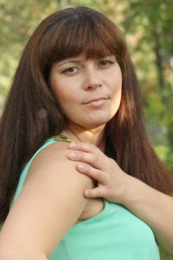 Ukrainian girl Marina,32 years old with grey eyes and light brown hair.
