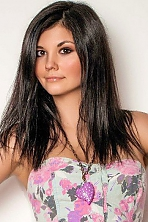 Ukrainian girl Anastasiya,23 years old with hazel eyes and black hair.
