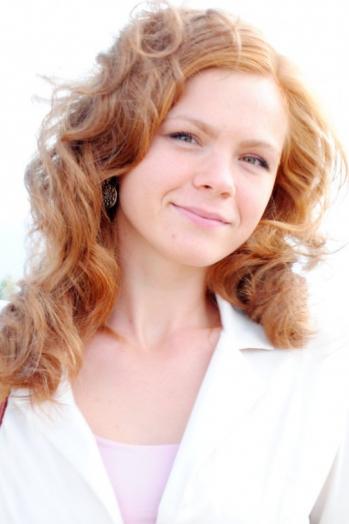 Ukrainian girl Nataliya,27 years old with brown eyes and red hair.