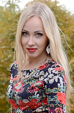 Ukrainian girl Anastasia,27 years old with green eyes and blonde hair.