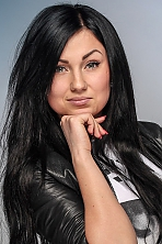 Ukrainian girl Anastasiya,21 years old with green eyes and black hair.