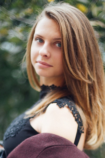 Ukrainian girl Anastasia,20 years old with blue eyes and light brown hair.