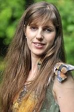 Ukrainian girl Oksana,32 years old with grey eyes and light brown hair.