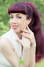 Ukrainian girl Viktoriya,39 years old with blue eyes and dark brown hair.