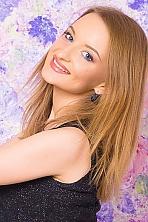 Ukrainian girl Olga,20 years old with green eyes and blonde hair.