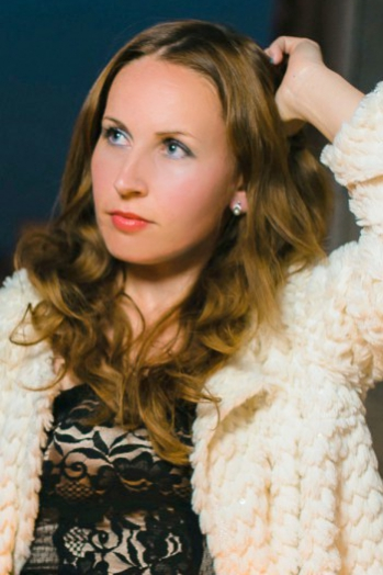 Ukrainian girl Viktoria,32 years old with blue eyes and light brown hair.