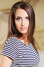 Ukrainian girl Marina,30 years old with blue eyes and dark brown hair.