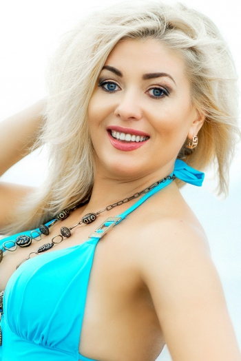 Ukrainian girl Nataliya,44 years old with blue eyes and blonde hair.