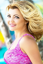 Ukrainian girl Tatjana,42 years old with green eyes and blonde hair.