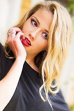Ukrainian girl Alina,22 years old with blue eyes and blonde hair.
