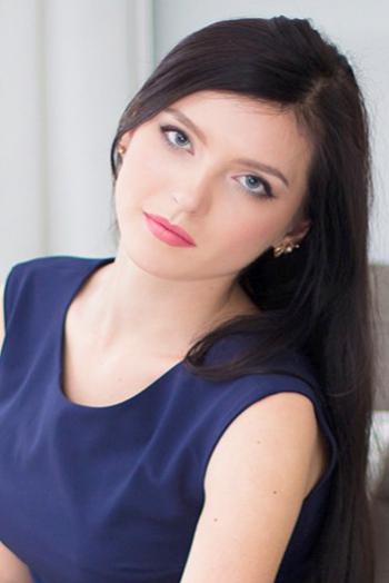 Ukrainian girl Alina,22 years old with blue eyes and dark brown hair.