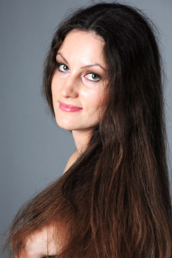 Ukrainian girl Irina,27 years old with green eyes and dark brown hair.
