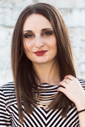 Ukrainian girl Darina,20 years old with blue eyes and dark brown hair.