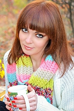Ukrainian girl Elena,31 years old with brown eyes and auburn hair.