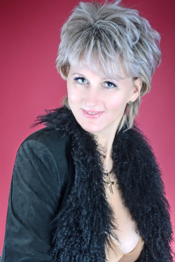 Ukrainian girl Irina,45 years old with blue eyes and blonde hair.