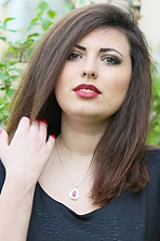 Ukrainian girl Marina,24 years old with green eyes and black hair.