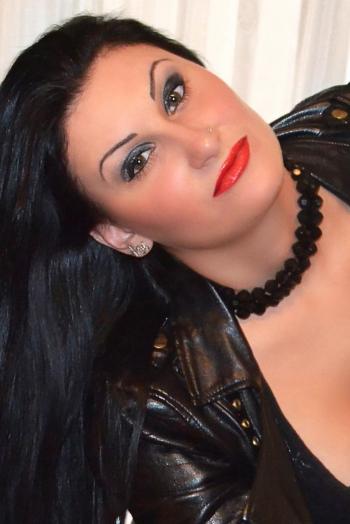 Ukrainian girl Veronika,24 years old with green eyes and black hair.