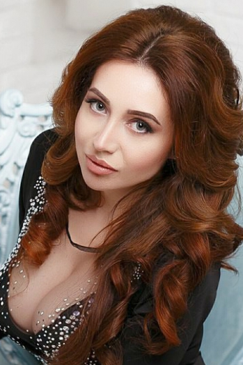 Ukrainian girl Svetlana,28 years old with grey eyes and light brown hair.