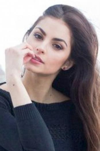 Ukrainian girl Lidia,28 years old with brown eyes and dark brown hair.