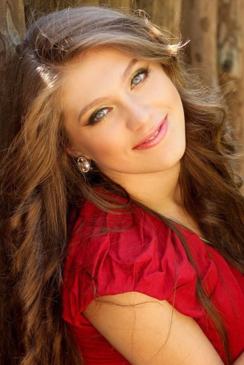 Ukrainian girl Svetlana,21 years old with blue eyes and light brown hair.