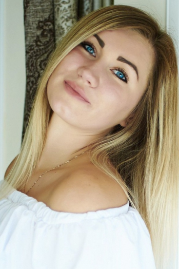 Ukrainian girl Alena,23 years old with blue eyes and blonde hair.