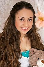 Ukrainian girl Alina,19 years old with green eyes and auburn hair.