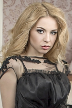 Ukrainian girl Nataliya,20 years old with grey eyes and blonde hair.