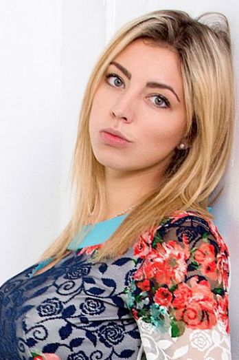 Ukrainian girl Julia,22 years old with blue eyes and blonde hair.