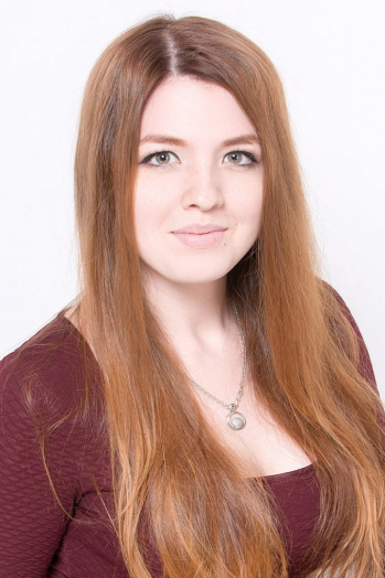 Ukrainian girl Catherine,20 years old with green eyes and red hair.