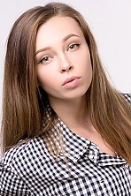 Ukrainian girl Julia,21 years old with green eyes and light brown hair.
