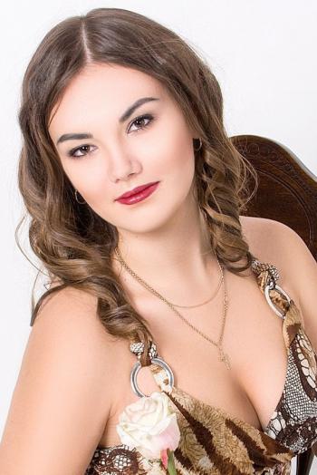 Ukrainian girl Margarita,22 years old with brown eyes and dark brown hair.
