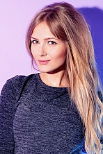 Ukrainian girl Lina,29 years old with brown eyes and blonde hair.