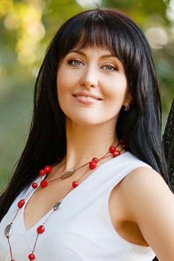 Ukrainian girl Tatiana,44 years old with grey eyes and dark brown hair.