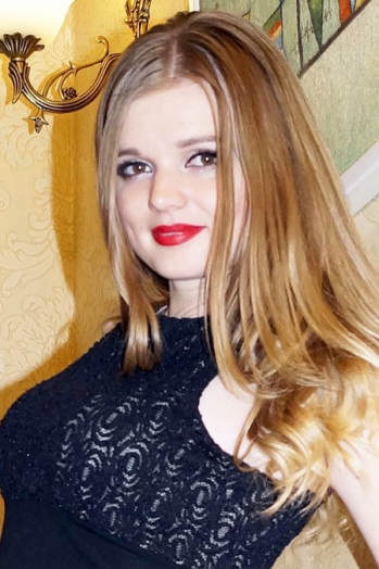 Ukrainian girl Ilona,22 years old with brown eyes and blonde hair.