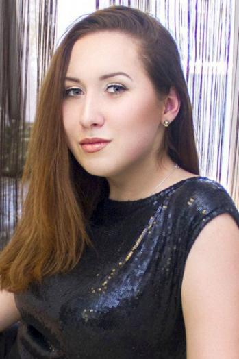 Ukrainian girl Anastasia,21 years old with brown eyes and dark brown hair.