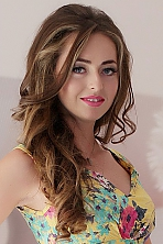 Ukrainian girl Nato,25 years old with blue eyes and light brown hair.